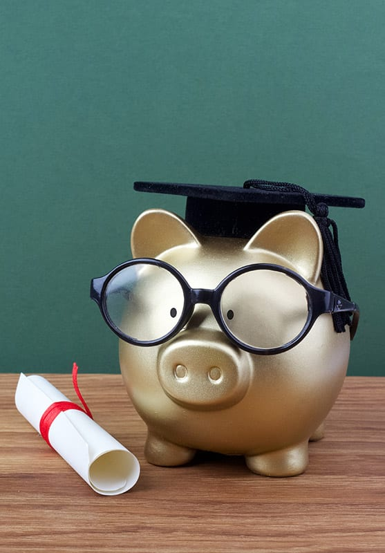 Piggy bank with diploma